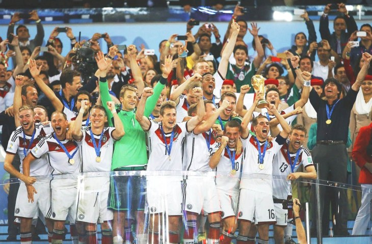 Germany's players celebrate with the trophy after winning their 2014 World Cup final against Argentina at the Maracana stadium in Rio de Janeiro